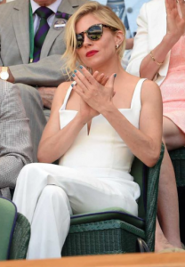 Actress Sienna Miller rocking Old Hollywood glamour in a white jumpsuit with a gorgeous up-do. Image credit: Pinterest.